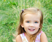 Cute little girl on the meadow — Стоковое фото