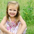 Cute little girl on the meadow — Stock Photo #12465974