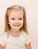 Portrait of smiling little girl — Stok fotoğraf