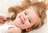 Little girl resting in the bed — Stock Photo