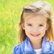 Stock Photo: Cute little girl on meadow