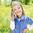 Portrait of cute little girl speaking by phone — Stock Photo