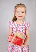 Portrait of little girl holding the gift box — Stock Photo