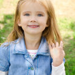Outdoor portrait of little girl — Stock Photo