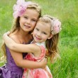 Portrait of two embracing cute little girls — Stock Photo