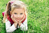 Outdoor portrait of cute little girl — Stock Photo