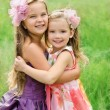 Portrait of two embracing cute little girls — Stock Photo #13846502