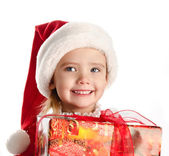 Happy little girl with christmas present — Stock Photo