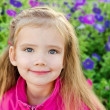 Royalty-Free Stock Photo: Outdoor portrait of cute little girl near the flowers