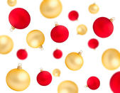 Falling red and gold christmas balls isolated — Stock Photo