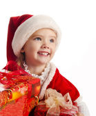 Little girl in christmas hat with gift boxes — Stock Photo