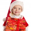 Stock Photo: Happy little girl with christmas present smiling