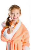 Little girl in dressing gown brushing her teeth isolated — Stock Photo