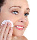 Skincare attractive girl applying face pack — Stock Photo