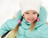 Little girl sitting on her sledge in winter day — Stock Photo
