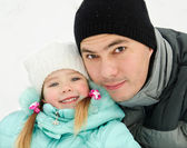 Outdoor portrait of smiling little girl with father — Stok fotoğraf