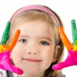 Stock Photo: Smiling little girl with hands in paint isolated on white