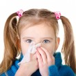 Stock Photo: Little girl blowing her nose closeup isolated