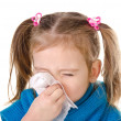 Little girl blowing her nose in a great effort closeup isolated — Stock Photo #17697855