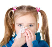 Little girl blowing her nose closeup isolated — Stock Photo