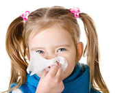 Little girl blowing her nose in a great effort closeup isolated — Stock Photo