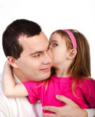 Little girl telling something her smiling father isolated — Stock Photo