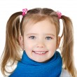 Portrait of smiling cute little girl in blue scarf — Stock Photo
