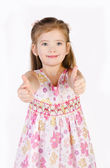 Cute little girl holding thumbs up isolated — Stock Photo