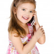 Happy little girl speaking by cell phone — Stock Photo #18922285