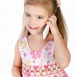 Smiling little girl speaking by cell phone — Stock Photo #18922289