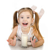 Cute smiling little girl is drinking milk isolated — Stock Photo