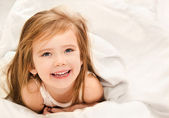 Adorable little girl awaked up — Stock Photo
