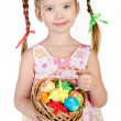 Smiling little girl with basket full of colorful easter eggs iso — Stock Photo #21903973