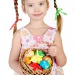 Smiling little girl with basket full of colorful easter eggs iso — Stock Photo