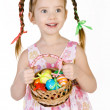 Smiling little girl with basket full of colorful easter eggs iso — Stock Photo #22166261