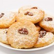 Heap of delicious cookies on a plate isolated — Stock Photo #22608237