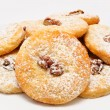 Heap of delicious cookies icing sugar with walnut isolated — Stock Photo