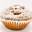 Muffin icing sugar isolated on a white — Stock Photo