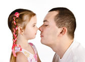 Little girl kissing her father isolated — Stock Photo