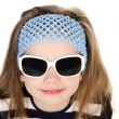 Stock Photo: Portrait of cute smiling little girl in sunglasses isolated