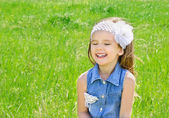 Laughing cute little girl on the meadow — Stock Photo