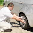 Car wheel defect man change puncture - Stock Photo