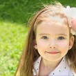Cute smiling little girl on the meadow — Foto Stock
