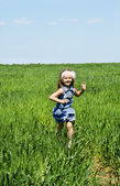 Little girl running on a meadow — Stock Photo
