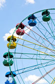 Big wheel with multicolored cabins — Stock Photo
