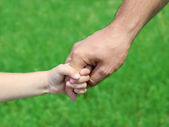 Child holds the hand of the father — Stock Photo