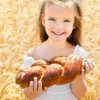 Happy girl on field of wheat  — Stockfoto