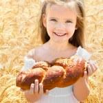Happy girl on field of wheat — Stock Photo