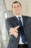 Businessman male hand reached to seal the agreement — Stock Photo