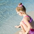 Little girl having fun on beach vacation — Stock Photo